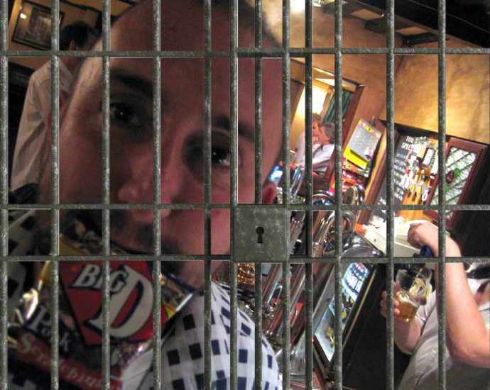 pork scratching theif behind bars 690x550 - Can you go to Jail for Stealing Pork Scratchings?