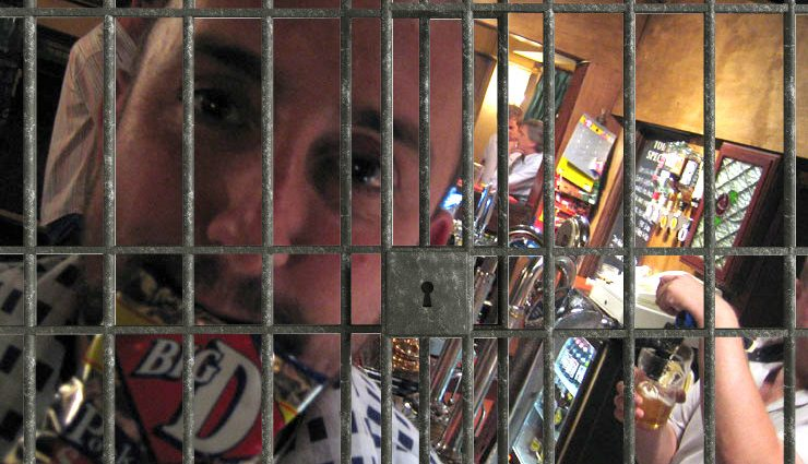 pork scratching theif behind bars 740x425 - Can you go to Jail for Stealing Pork Scratchings?