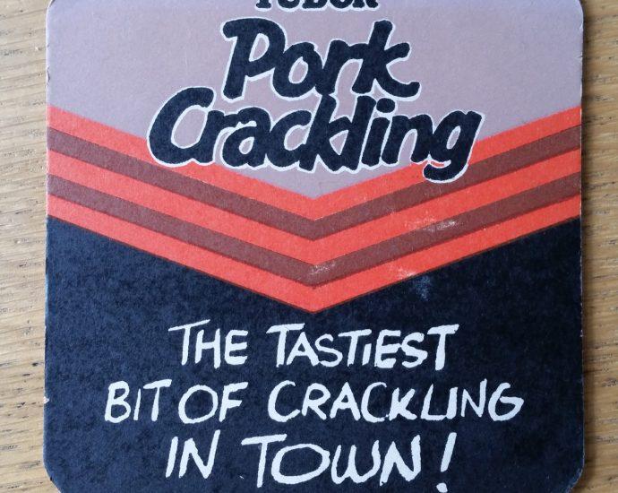 vintage tudor pork crackling beer mat 01 front 690x550 - Smiths Pork Crackling Flavour Potato Crisps - Beer Mat
