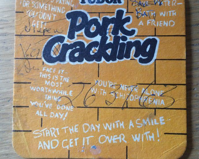 vintage tudor pork crackling beer mat 02 front 690x550 - Smiths Pork Crackling Flavour Potato Crisps - Beer Mat